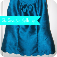 she sews sea shells silk top
