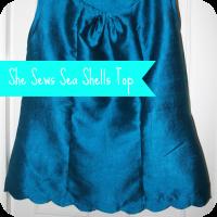 she sews sea shells silk top